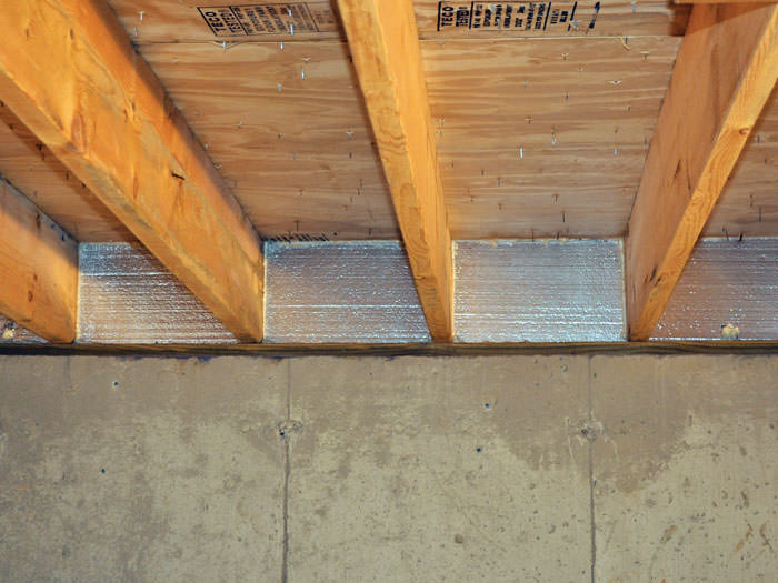 Silverglo Insulation Installed In A Floor Joist Glenwood Springs