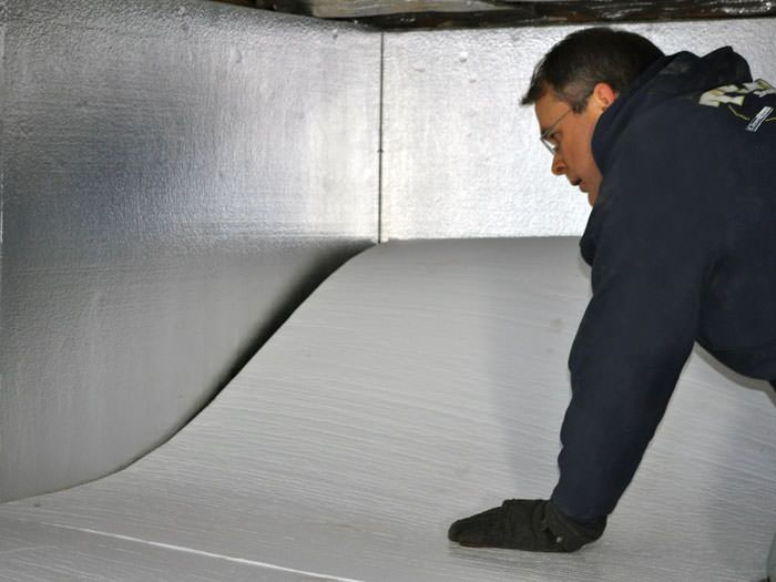 Crawl space insulation with terrablock in colorado insulating a contractor installing terrablock floor insulation in a salida crawl space solutioingenieria Choice Image