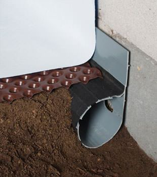 Closeup of a crawl space drainage system installed in Idaho Springs